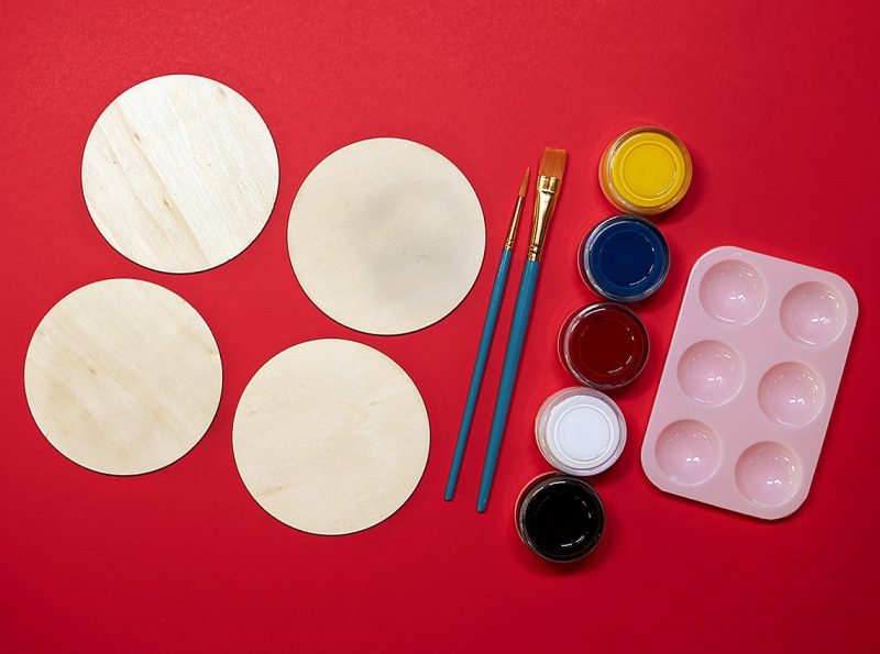 painting supplies and wood coasters